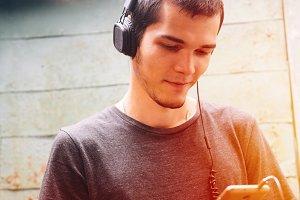 Handsome man in headphones listening