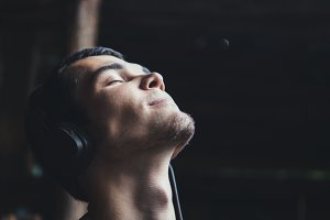 A man enjoys listening to music