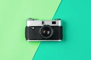 retro camera on color pastel backgro