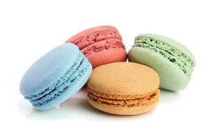four macaroons isolated on white