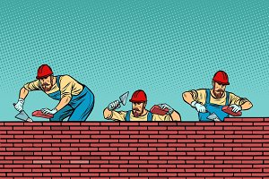 construction team laying a brick