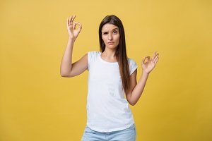 Happy young woman showing ok sign