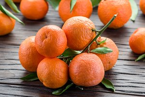 Ripe tangerines on wooden table.