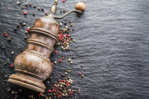 Colorful peppercorns and old pepper
