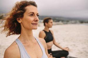 Fitness women doing yoga sitting