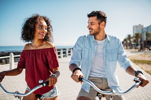 Romantic couple riding bicycles