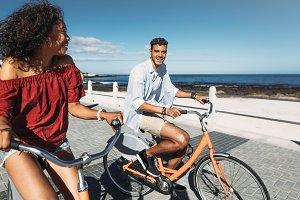 Tourist couple riding bicycles