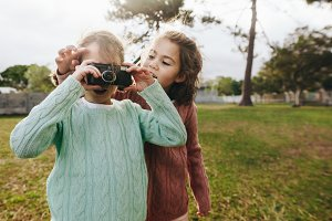 Little girls taking pictures