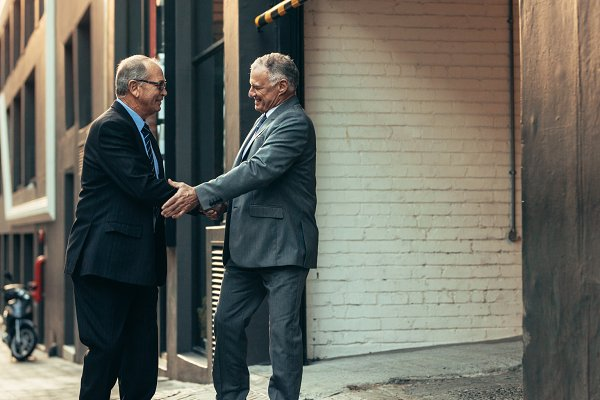 Senior businessmen handshake