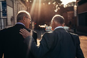Senior businessman walking together