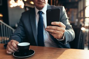 Senior businessman using smartphone