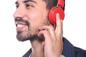 Young latin man listening to music