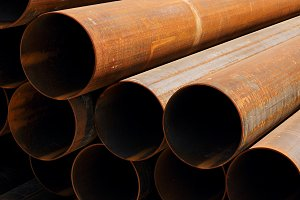 stack of rusty pipes