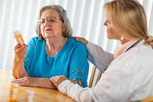 Female Nurse Consulting Elderly Lady