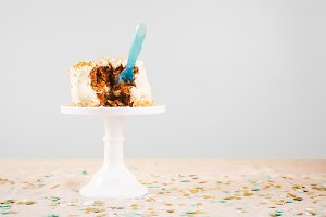 Damaged birthday cake with spoon