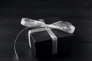 Black gift box with silver bow