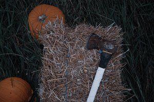 Rusty Axe on Hay with Pumpkins