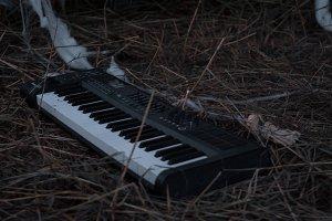 Trashed Abandoned Keyboard in Field