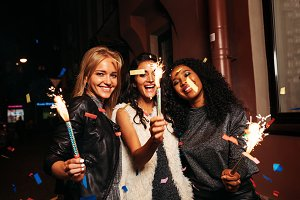 Three female friends with sparklers