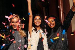 Three diverse women celebrating