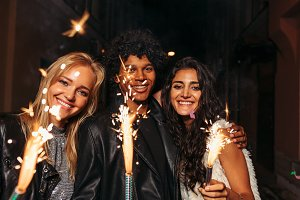 Young man and women with sparklers