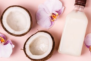 Coconut oil and halves of fresh coco