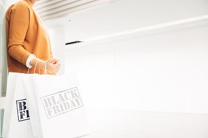 Female shopper holds black friday ba