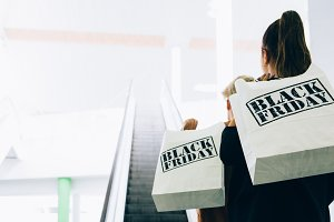 Female shoppers with shopping bags