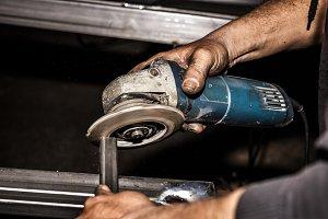Craftsman sawing metal