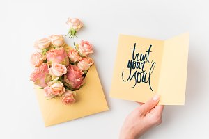 hand holding paper with TRUST YOUR S