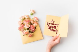 hand holding paper with DO SOMETHING