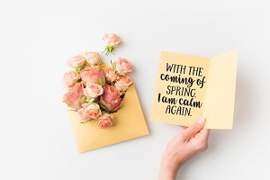 hand holding paper with spring quote