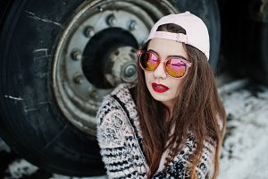 Brunette stylish casual girl in cap