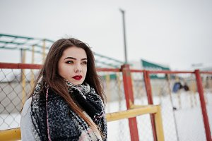 Brunette casual girl in scarf at win