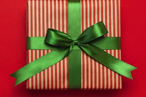 Gift box with green ribbon, present
