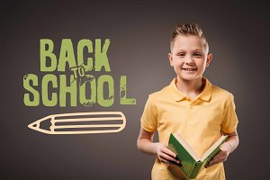 preteen boy holding book, isolated o
