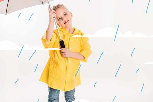 little child in yellow raincoat with