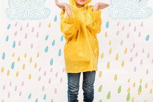 little kid in yellow raincoat and ru