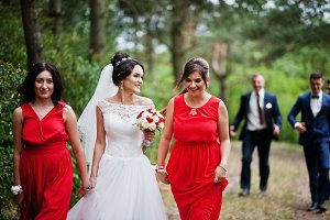 Stunning bride with bridesmaids walk