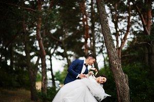 Beautiful young wedding couple admir
