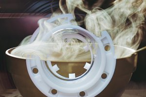Hot latte cup seen through tape cass