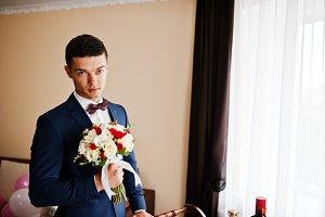 Portrait of a handsome groom standin
