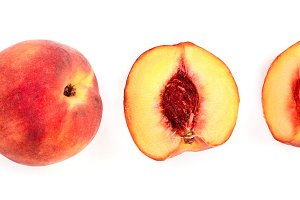 ripe peaches and half isolated on
