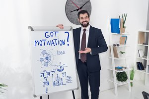 smiling businessman pointing at whit
