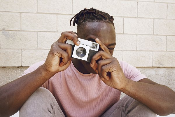 People Stock Photos: NanihtaCreative - Young man taking shots with a camera