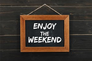 blackboard with enjoy the weekend in