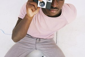 Young man taking shots with a camera