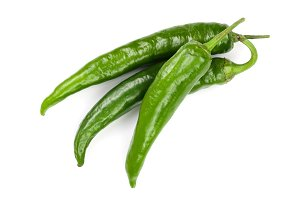 green hot chili peppers isolated on