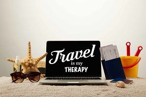 """close up view of laptop with """"travel"""