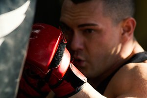 Muscular bodybuilder putting in